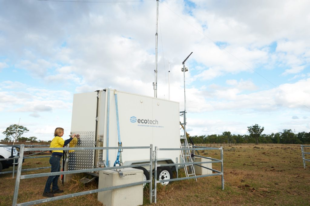 Scientist opening door to air monitoring station