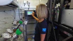 Researcher adjusting air monitor settings